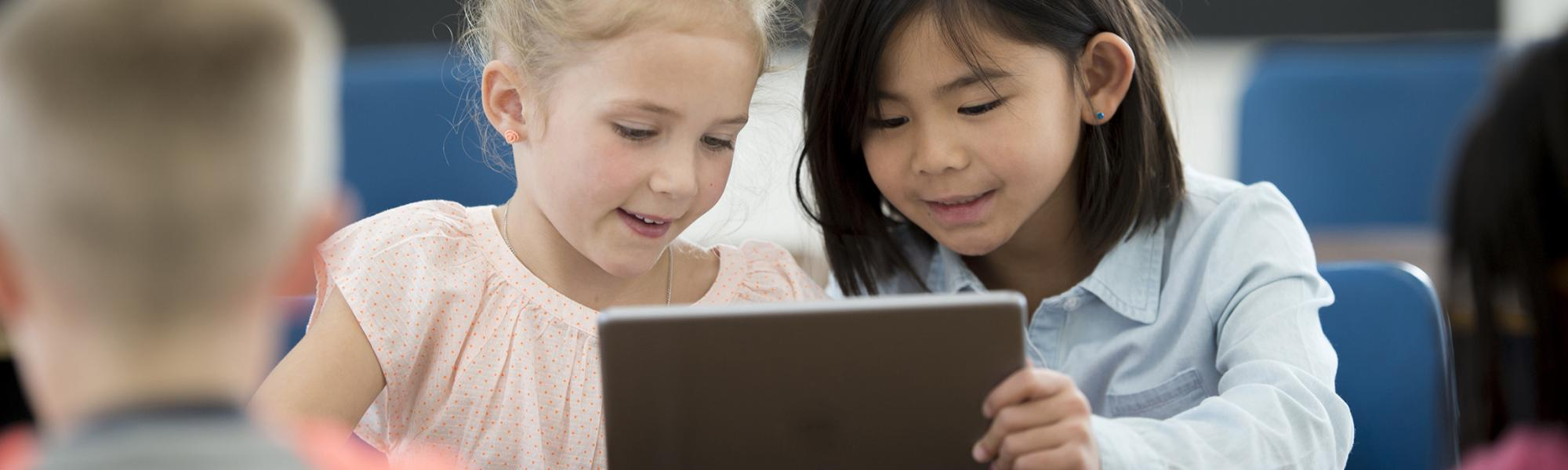Children learning on tablet