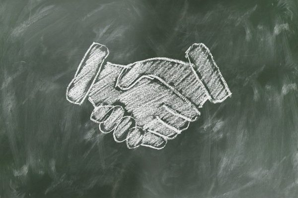 chalk board drawing of shaking hands